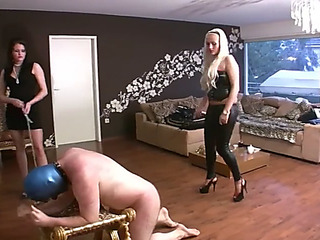Merciless caning by 2 woman