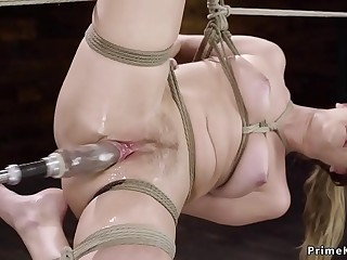 Squirting babe fucked by machine