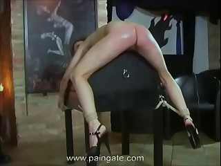 Cruel asswhipping for arrogant dancing girl  she twists under the lash but cannot escape the blows!