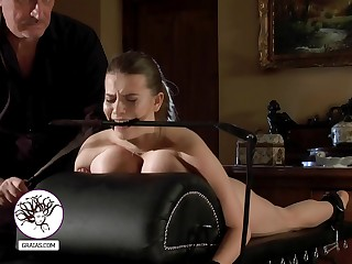 Slave girl with huge boobs used as a training instrument