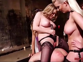 Group of ladies fucking a dude in bondage