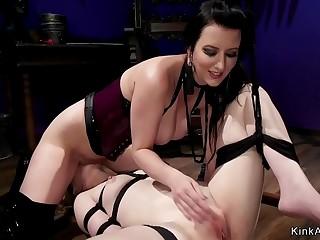 Brunette lesbian ass whipped in bondage