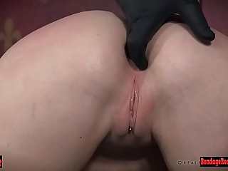 Bdsm babe is punished in downward pose