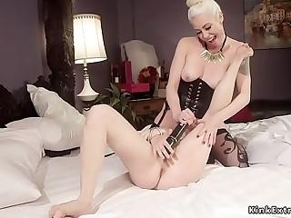 Blonde lesbian whips redhead slave