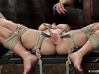Natural busty slave in heavy bondage