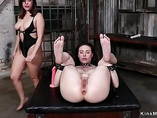 Huge ass mistress takes toy up her ass