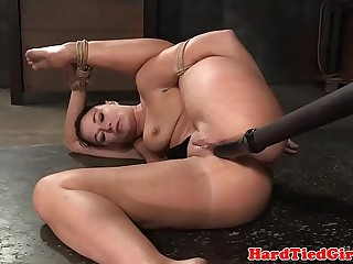 Gagged submissive beauty sucking on dildo