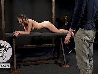 Little slut on all fours receive the whip