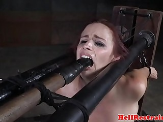 Flogged submissive babe sucking on dildo